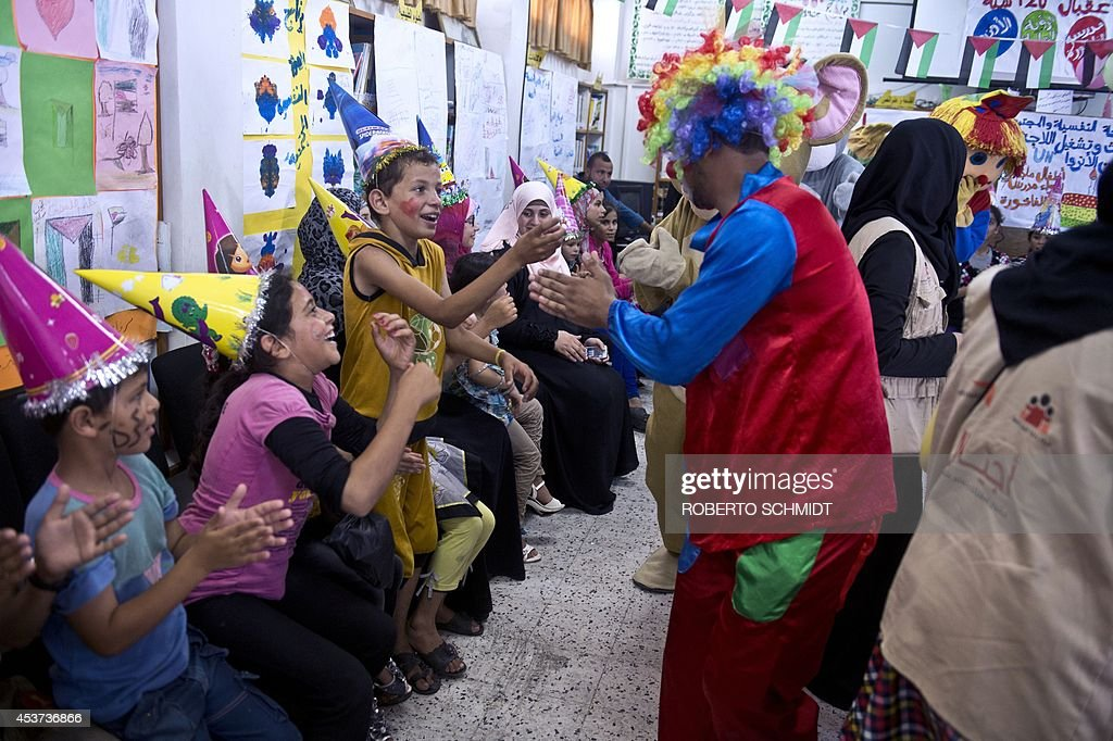 Palestinian children who were displaced from their home by fighting between Hamas and Israel attend a birthday party at a UN school in Jabalia in the...