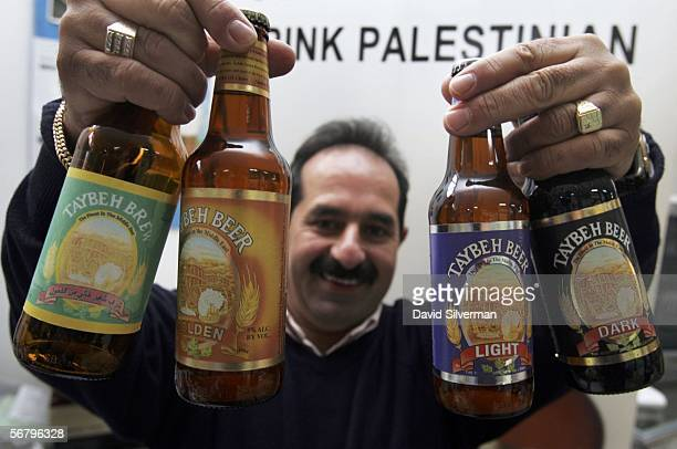 Palestinian Christian brewer Nadim Khoury shows a prototype green label for an alcoholfree beer along with his current products of Golden Lager and...