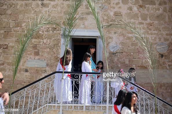 Palestinian Christian girls take part in the Greek Orthodox Christian Palm Sunday celebrations at StPorphyrios Church in Gaza City on April 24 2016...