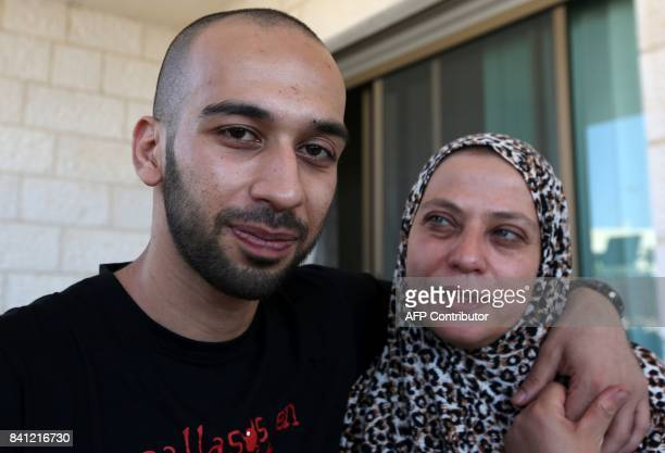Palestinian clown Mohammad Abu Sakha poses with his mother at his family home in the West Bank city of Jenin following his release on August 31 2017...