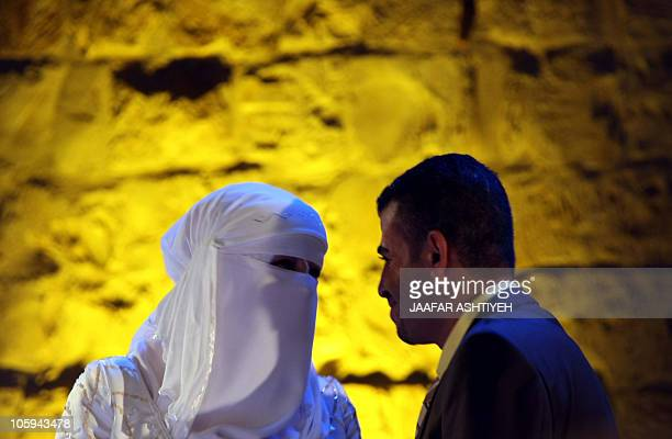 A Palestinian couple attends a mass wedding in the northern West Bank city of Nablus as 49 Muslim couples tie the knot on October 21 2010 AFP...