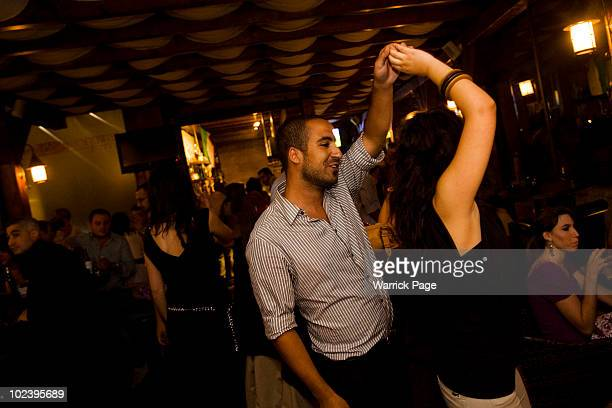 Palestinian couple dance in the Orjuwan Lounge on June 24 2010 in Ramallah West Bank Nightlife in Ramallah is on the rise as numerous restaurants and...