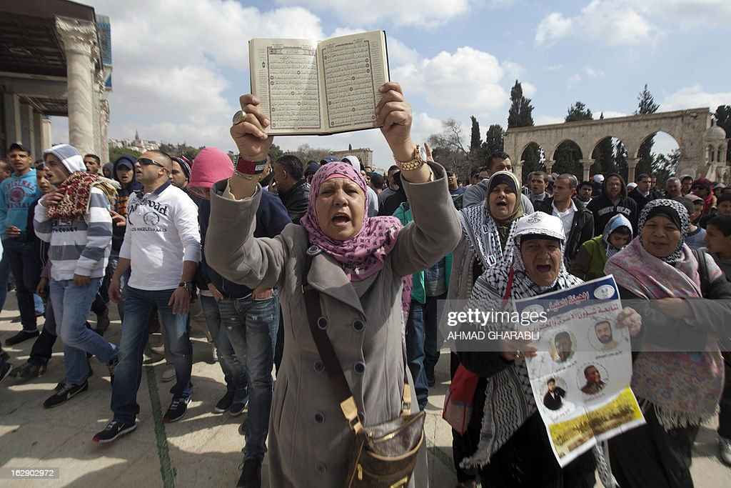 A Palestinian demonstrator holds up a Koran, Islam's holy book, shouting slogans during a protest outside Jerusalem's al-Aqsa mosque in solidarity with hunger-striking Palestinian prisoners held in Israeli jails on March 1, 2013. Protests in support of Palestinian prisoners on hunger strike in Israeli prisons have been building and gained new momentum with the death in his cell of 30-year-old Arafat Jaradat in still uncleared circumstances.