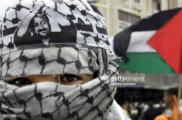 Palestinian demonstrator takes part in a protest in support of Palestinian member of the Fatah movement Marwan Barghuti in the West Bank city of...