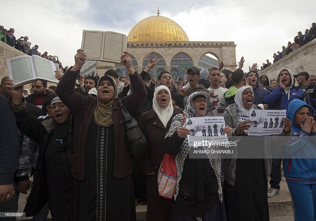 Palestinian demonstrators chant slogans during a protest at Jerusalem's Al-Aqsa mosque in solidarity with hunger-striking Palestinian prisoners on February 22, 2013. Palestinians demanding the release of hunger-striking prisoners clashed with Israelis in the West Bank and east Jerusalem, as three fasting inmates were taken to hospitals.