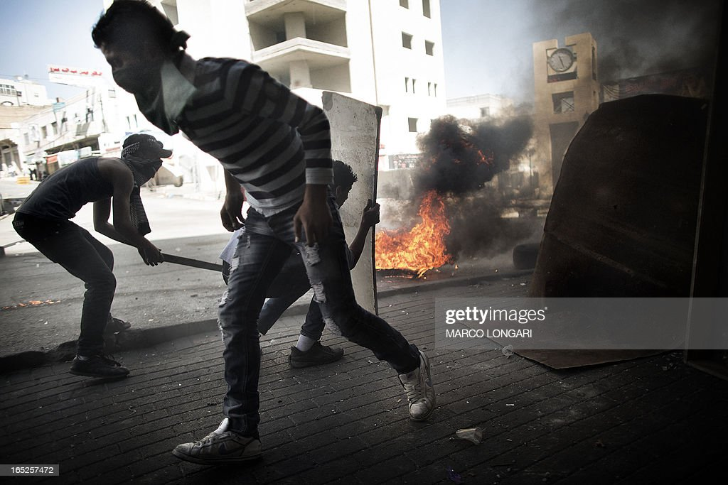 Palestinian demonstrators clash with the Israeli army in the streets of the West Bank city of Hebron following the death of a Palestinian prisoner on April 2, 2013. The Palestinian leadership blamed Israel for the death of Maisara Abu Hamdiyeh, a long-term prisoner with cancer, hiking tensions over a tinderbox issue closely followed on the Palestinian street.