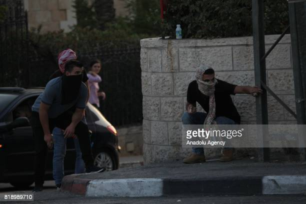 Palestinian demonstrators throw rocks in response to Israeli security forces' intervention with tear gas and plastic bullets during a protest Israeli...