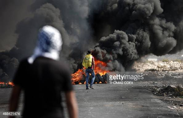 Palestinian demonstrators throw stones at Israeli security forces during clashes in the West Bank town of AlBireh on the northern outskirts of...