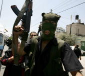 Palestinian demonstrators try to convince Fatah militants to stop shooting during clashes with Hamas militants on June 13 2007 in Gaza City Gaza...