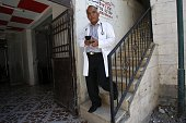 Palestinian doctor Ali Shroukh walks down the stairs at his private clinic on July 11 2016 in the southern West Bank village of Dahriya near Hebron...
