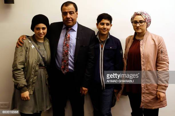 CORRECTION Palestinian doctor Izzeldin Abuelaish poses for a photo with his children Shada Rafa and Abdallah following a press conference on March 14...