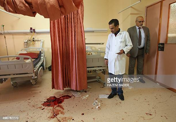 A Palestinian doctor looks at blood stains on the floor at alAhli hospital in the West Bank town of Hebron after a man was shot dead during a raid by...