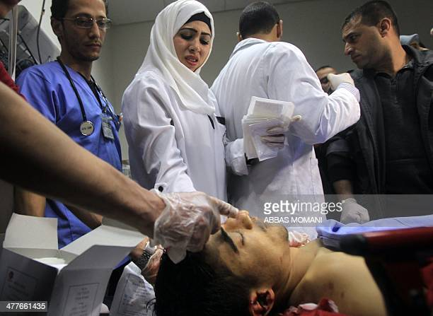 Palestinian doctors check the body of Saji Sayel Darwish a Palestinian youth who was shot dead by Israeli forces on a road near the West Bank...