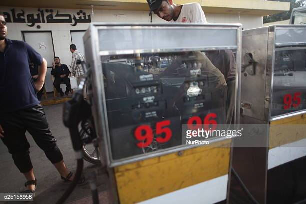A Palestinian employee fills a car with benzin at a fuel station in Gaza city 24 October 2013 Reports state that Gaza officials have said the unrest...