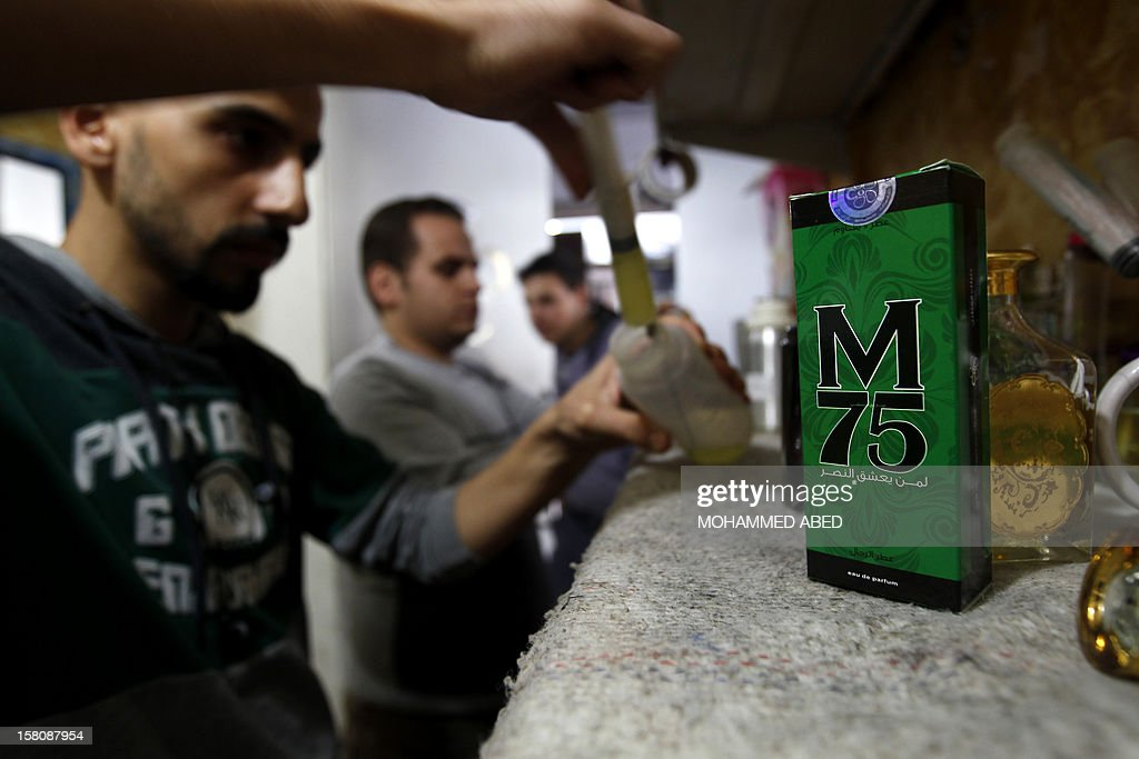 A Palestinian employee of the 'Stay Stylish' shop fills an M75 perfume bottle in Gaza City on December 10, 2012. 'Victory' has never smelled so sweet -- or at least that's what they would have you believe at the shop selling Gaza's newest fragrance named M75 after a long-range Hamas rocket.
