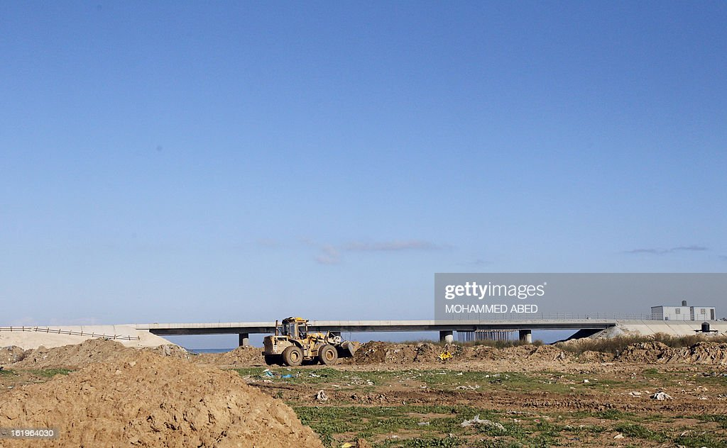 Palestinian employees work on the reconstruction of a bridge linking Gaza City to the central Gaza Strip which was destroyed during Israel's last military assault on the Hamas-run Palestinian territory, on February 18, 2013 .