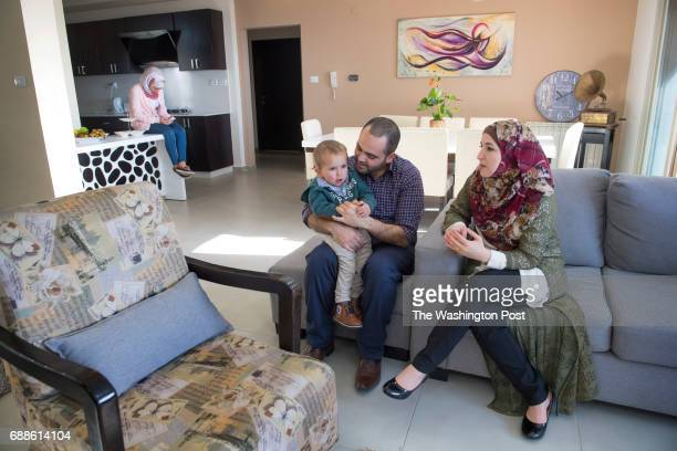 Palestinian family Jihad Kmail his wife Isia Sarsour and son Mahmoud Kmail in their apartment at Rawabi a highend multiuse development in Rawabi West...