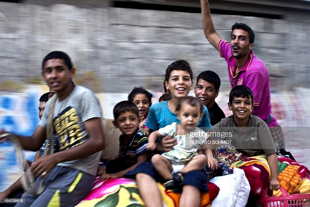 A Palestinian family ride on top of a horse cart as they head home with their belongings in the Shejaiya neighborhood on August 27, 2014. The Shejaiya neighborhood was one of the hardest hit by the fighting. The skies over the Gaza Strip were calm Wednesday as a long-term ceasefire between Israel and the Palestinians took hold after 50 days of the deadliest violence in a decade.