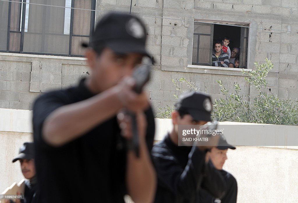 A Palestinian family watches students attending a training session organised by Hamas national security in the southern Gaza Strip city of Rafah on January 23, 2013. Israel's elections, which saw an even split between rightwing and centre-left blocs, are unlikely to produce a coalition bent on reviving peace talks, a Palestinian official said.