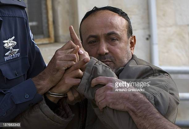 Palestinian Fatah leader Marwan Barghouti is escorted by Israeli police into the Magistrate's Court for a hearing in Jerusalem on January 25 2012...