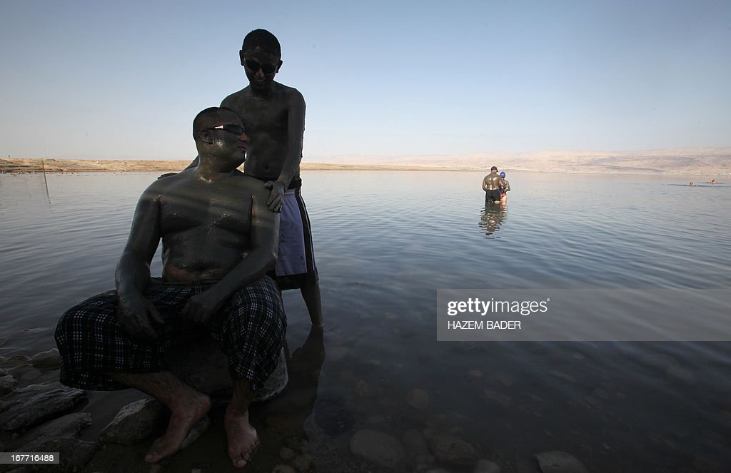 A Palestinian father and his son enjoy the Dead Sea at the Biankini beach located along the northern shore near the city of Jerico, in the Israeli occupied West Bank, on April 28, 2013. Palestinians can access this area of the Dead Sea without an Israeli government permit.