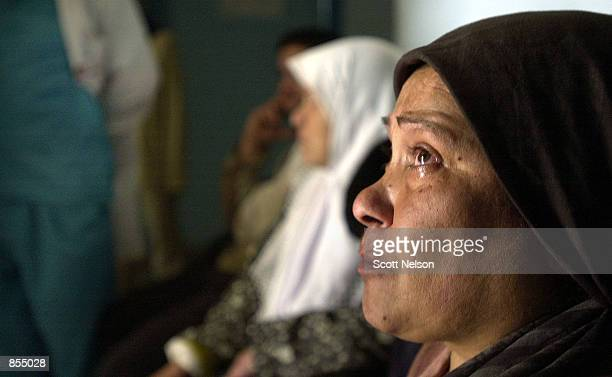 Palestinian Fathia Nimer weeps as she watches news of the Israeli miltary operation in the Palestinian West Bank town of Jenin April 11 2002 from the...