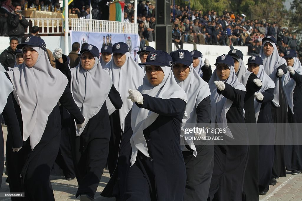 Palestinian female graduates members of Hamas' national security forces march during a parade as part of a graduation ceremony in Gaza City on January 3, 2013.