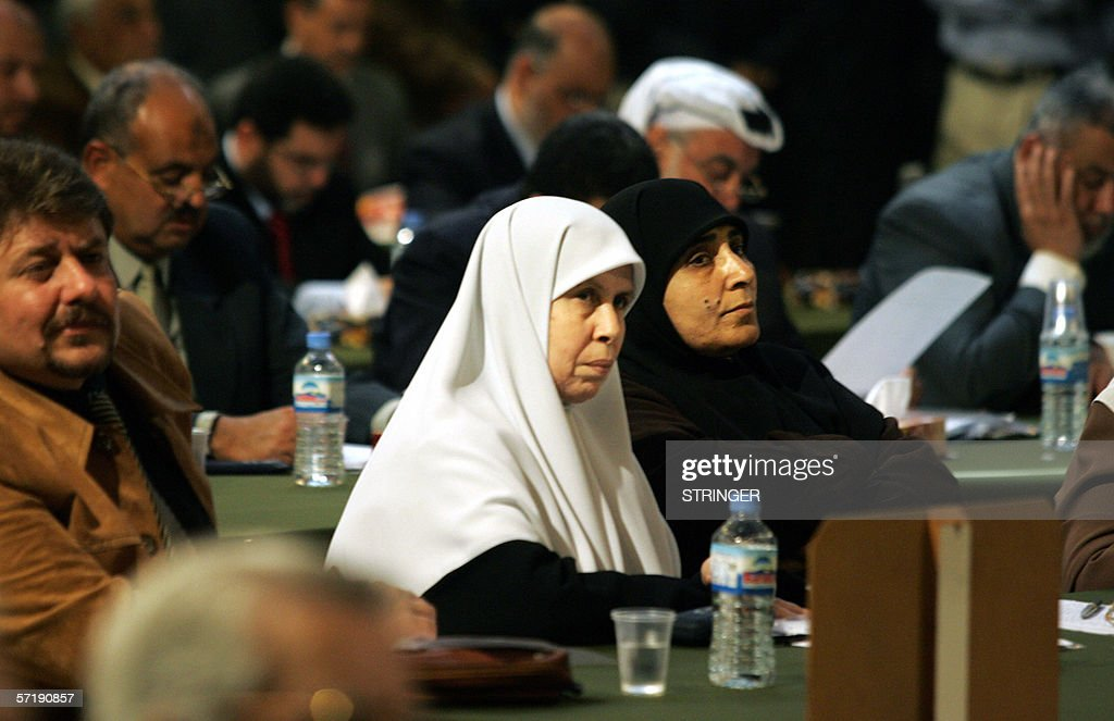 Palestinian female legislator Mariam Farhat (L) and Jamila al-Shanti listen on during a parliament session in Gaza City 27 March 2006. Haniya pledged his Hamas government would spare no effort in striving for peace in the Middle East as MPs prepared to approve his cabinet line-up.