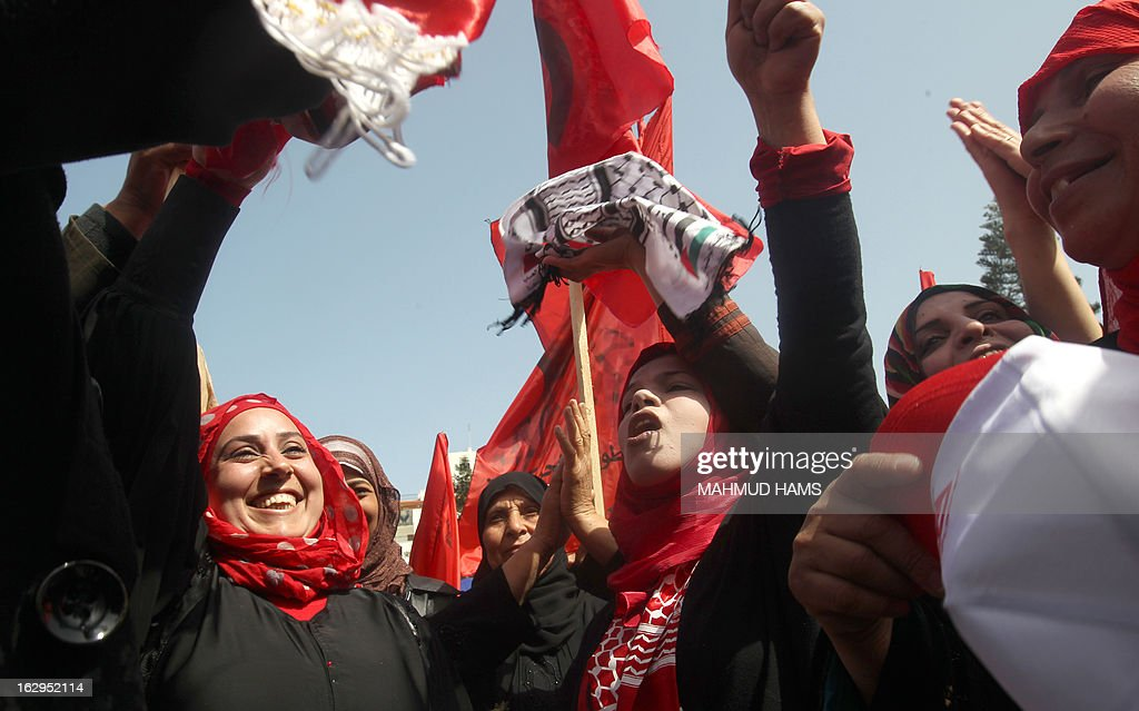 Palestinian female supporters of the Popular Front for the Liberation of Palestine (PFLP), a Palestinian Marxist-Leninist and revolutionary leftist organization founded in 1967, celebrate the 46th anniversary of its foundation in Gaza City on March 2, 2013. AFP PHOTO / MAHMUD HAMS