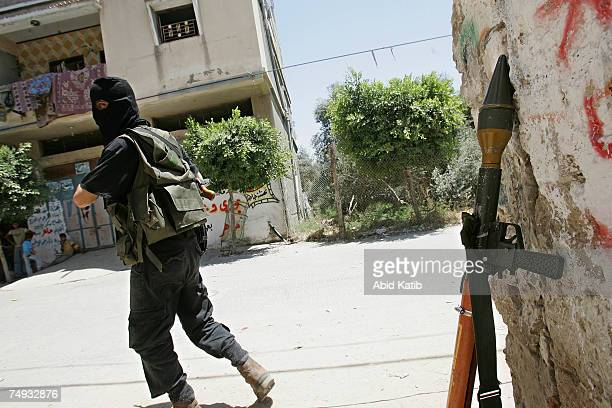 Palestinian fighter from Ezz ElDeen AlQassam the military wing of The Islamic Resistance Movement Hamas takes up position during clashes on June 27...