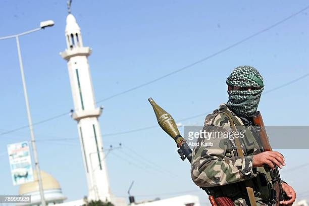 Palestinian fighters take their positions during an Israeli military operation January 15 in Gaza City Gaza Strip Israeli troops killed at 17...