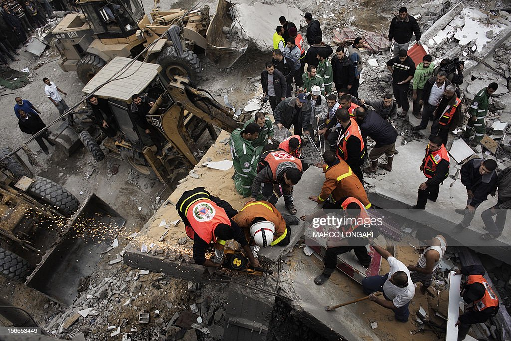 Palestinian firefighters and rescue personnel work at a blast site following an Israeli air raid in Gaza City on November 17, 2012. Israeli air strikes hit the cabinet headquarters of Gaza's Hamas government, the group said early on November 17, with eyewitnesses reporting extensive damage to the building.