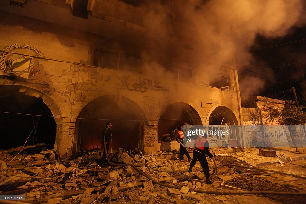 Palestinian firefighters try to extinguish a blaze after an Israeli air strike on the Islamic National Bank building in Gaza City on November 20, 2012. Israeli leaders discussed an Egyptian plan for a truce with Gaza's ruling Hamas, reports said, before a mission by the UN chief to Jerusalem and as the toll from Israeli raids on Gaza rose over 100.