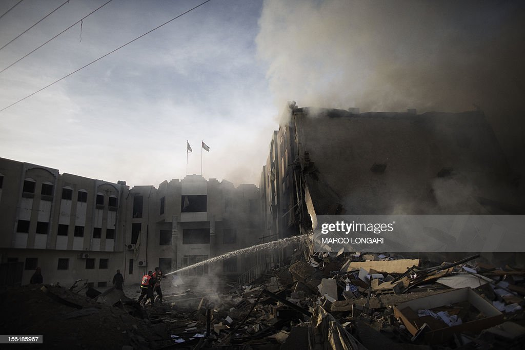 Palestinian firefighters try to extinguish a fire at the Civilian Affairs branch of the Ministry of Interior following an Israeli air raid in Gaza City on November 16, 2012. Israel was condemned by much of the Arab world while securing Western backing and pressing its biggest air assault on Gaza for years amid a wave of Palestinian short-range rocket fire.
