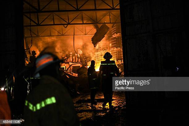Palestinian firefighters try to extinguish a fire in a factory for chemicals in the west of Gaza City because of an Israeli air strike the bombing...