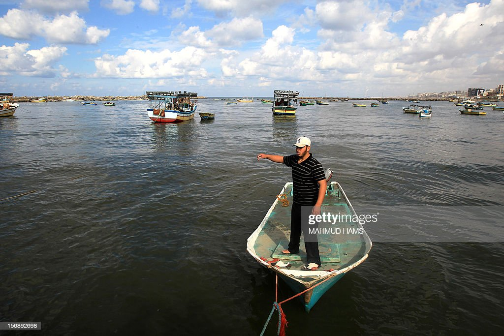 A Palestinian fisherman stands in his boat in the port of Gaza on the Mediterranean coast in Gaza City on November 24, 2012, as a fragile truce between Israel and militant groups in Gaza enters its third day. Israel slammed Palestinian president Mahmud Abbas for his support for Gaza following its confrontation with the Jewish state, while casting aspersions on the legitimacy of his upcoming UN statehood bid.