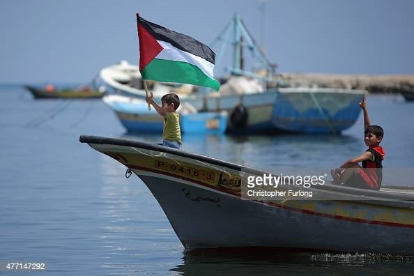 Palestinian fishermen and local children stage a protest against the Israel's ongoing blockade of the strip and it's port on June 14 Gaza City Gaza...