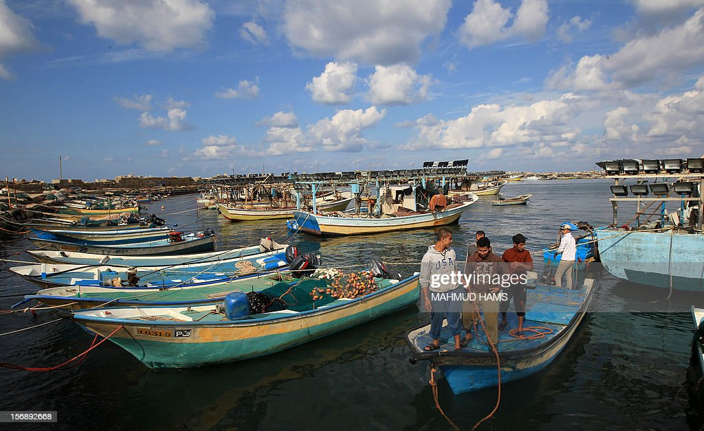 Palestinian fishermen prepare their boats in the port of Gaza on the Mediterranean coast in Gaza City November 24, 2012, as a fragile truce between Israel and militant groups in Gaza enters its third day. Israel slammed Palestinian president Mahmud Abbas for his support for Gaza following its confrontation with the Jewish state, while casting aspersions on the legitimacy of his upcoming UN statehood bid.