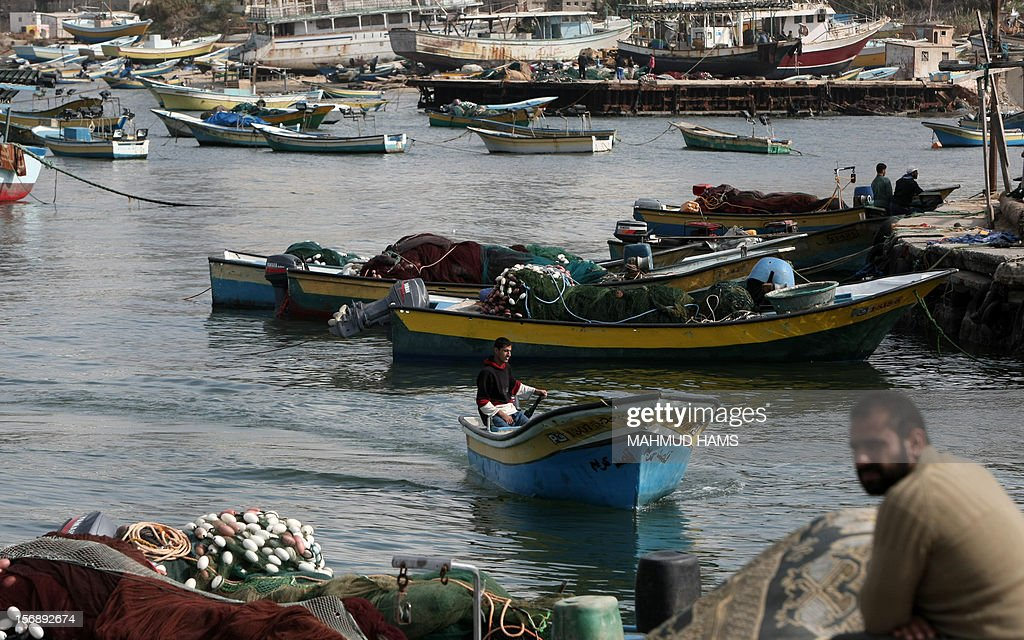 Palestinian fishermen prepare their boats in the port of Gaza on the Mediterranean coast in Gaza City on November 24, 2012, as a fragile truce between Israel and militant groups in Gaza enters its third day. Israel slammed Palestinian president Mahmud Abbas for his support for Gaza following its confrontation with the Jewish state, while casting aspersions on the legitimacy of his upcoming UN statehood bid.