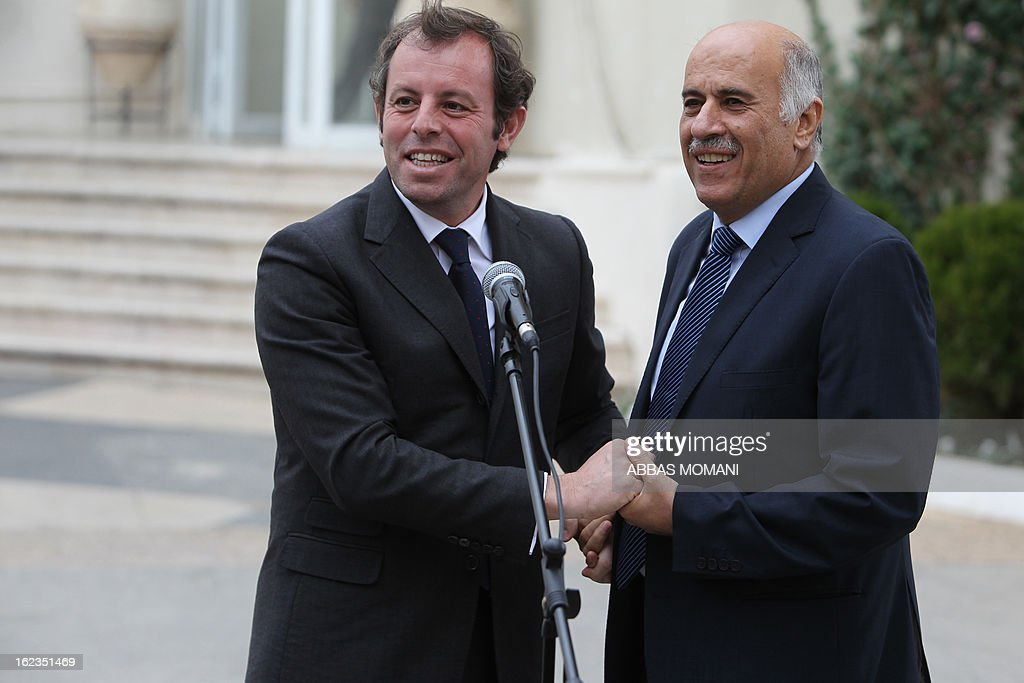 Palestinian Football Association chairman Jibril Rajoub (R) shakes hands with FC Barcelona football club's president Sandro Rosell (L) following a joint press conference in the West bank city of Ramallah, on February 22, 2013. Rosell is visiting to promote a football match between Israel and the Palestinians with players from both sides of the conflict as a step towards Middle East peace. AFP PHOTO/ABBAS MOMANI
