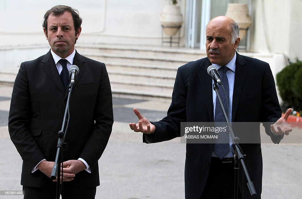 Palestinian Football Association chairman Jibril Rajoub (R) speaks during a joint press conference with FC Barcelona football club's president Sandro Rosell (L) in the West bank city of Ramallah, on February 22, 2013. Rosell is visiting to promote a football match between Israel and the Palestinians with players from both sides of the conflict as a step towards Middle East peace. AFP PHOTO/ABBAS MOMANI