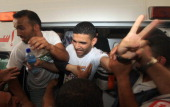 Palestinian football player Mahmud Sarsak who staged a hunger strike of nearly three months while in Israeli jail flashes the V for 'victory' sign as...