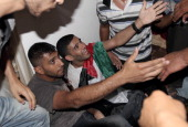 Palestinian football player Mahmud Sarsak who staged a hunger strike of nearly three months while in Israeli jail is surrounded by relatives and...