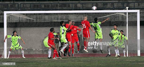 Palestinian football players attempt to score against the Pakistan team during an International friendly match in Lahore on March 1 2011 Palestine...