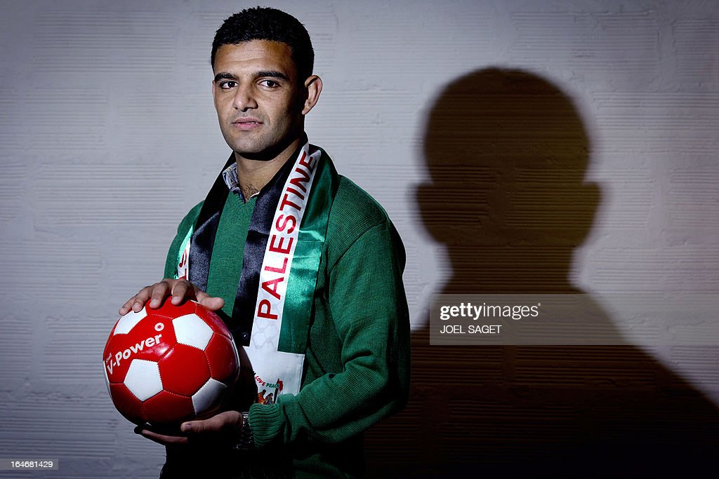 Palestinian footballer Mahmud Sarsak poses on March 26, 2013 in Paris, where he begins today a campaign for the cancelation of the under 21 Euro football championships to be held next June in Israel. Sarsak was arrested in July 2009 while on his way from Gaza to sign for a West Bank club and was held without charge under Israel's 'unlawful combatants' law. He staged a hunger strike of nearly three months before being freed from Jails. AFP PHOTO / JOEL SAGET