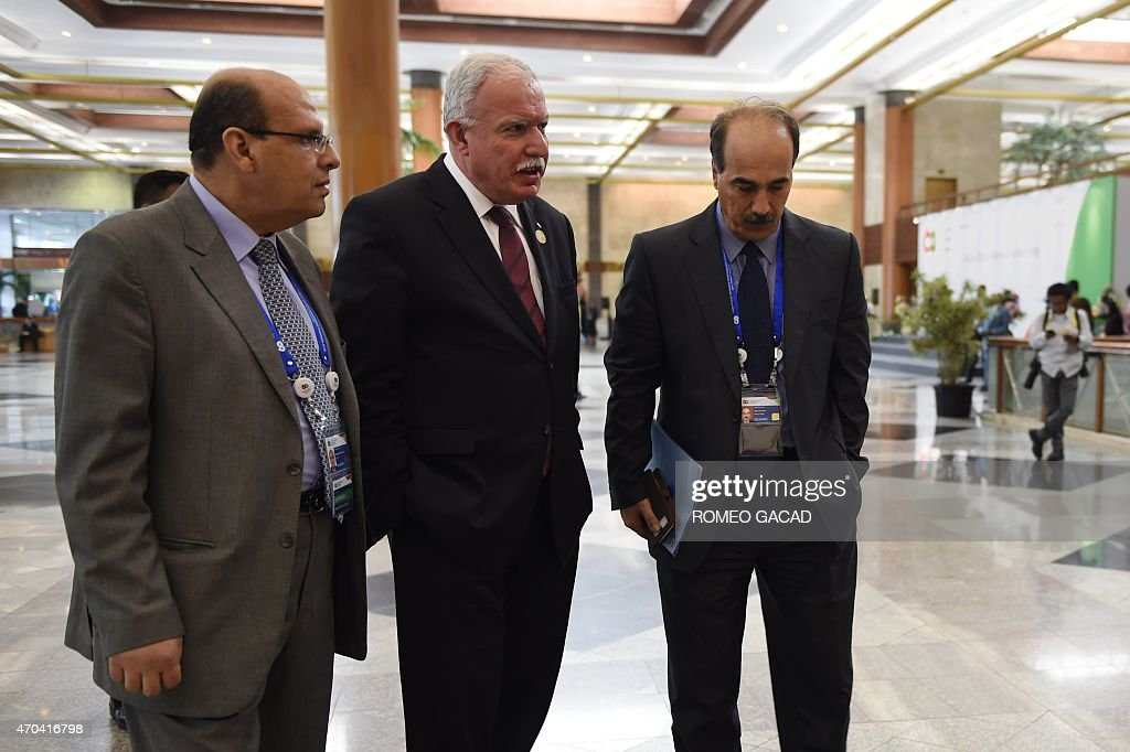 Palestinian Foreign Affairs Minister Riyad al-Malki (C) accompanied by unidentified senior officials arrives at the Asian-African Conference ministerial meeting in Jakarta April 20, 2015. Asian and African leaders gather in Indonesia this week to mark 60 years since a landmark conference that helped forge a common identity among emerging states, but analysts say big-power rivalries will overshadow proclamations of solidarity. AFP PHOTO / ROMEO GACAD