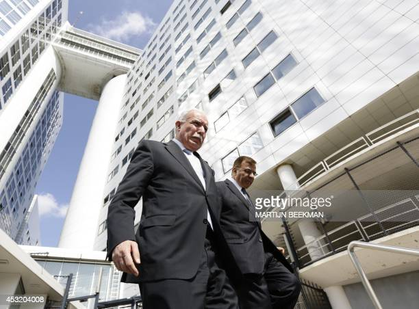 Palestinian Foreign Minister Riad alMalki and Palestinian Ambassador to the Netherlands Nabil Abuznaid leave the International Criminal Court in The...