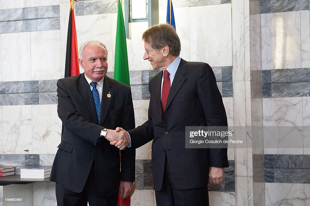 Palestinian Foreign Minister Riad Malki (L) shakes hand with Italian Foreign Minister Giulio Terzi prior a minsterial commitee at Farnesina on November 23, 2012 in Rome, Italy. Riad Malki announced that from now on Palestine will participate in the United Nations' meetings as an observer.