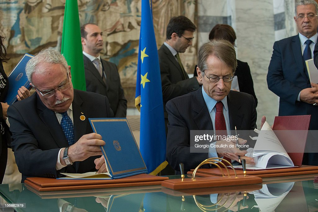 Palestinian Foreign Minister Riad Malki (L) signs with Italian Foreign Minister Giulio Terzi a bilateral agreement between Italy and Palestine during a minsterial commitee at Farnesina on November 23, 2012 in Rome, Italy. Riad Malki announced that from now on Palestine will participate in the United Nations' meetings as an observer.