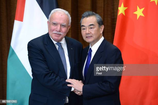 Palestinian Foreign Minister Riyad AlMaliki left talks with Chinese Foreign Minister Wang Yi before their meeting at the Ministry of Foreign Affairs...